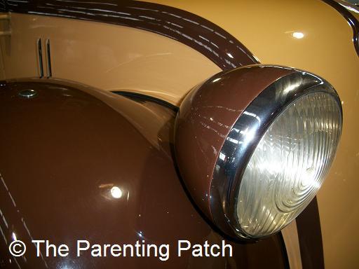 Headlight on a Brown Car