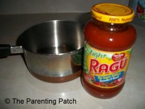 Opening the Ragu Sauce