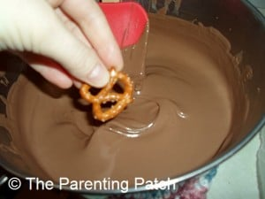 Dipping the Pretzel in Almond Bark