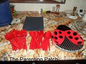 Ladybug Plates, Black Napkins, and Red Silverware