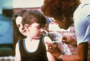 Nurse Vaccinating a Child