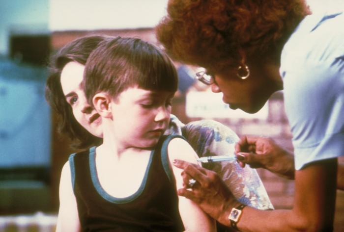 Nurse Vaccinating a Child