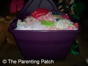 Container of Jumbled Baby Clothes