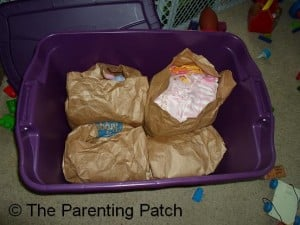 Container of Baby Clothes Organized by Size
