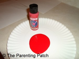 Pouring the Red Paint on the Paper Plate