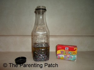 Glitter, Oil, and Food Coloring in Plastic Bottle