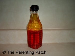 Oil, Water, and Plastic Baubles Sensory Bottle 1