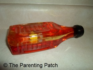 Oil, Water, and Plastic Baubles Sensory Bottle 2