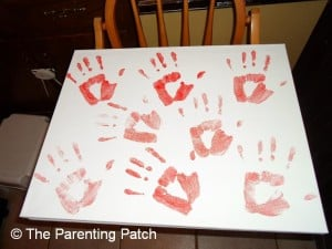 Red Handprints on Canvas