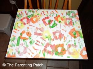 Green Handprints on Canvas