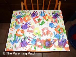 Purple Handprints on Canvas