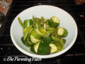 Cooked Sugar Snap Peas and Zucchini Slices