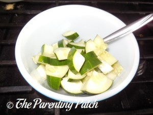 Adding the Sliced Cucumber to the Bowl