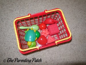 Basket of Red and Green Toys