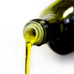 Pouring Olive Oil from Glass Jar
