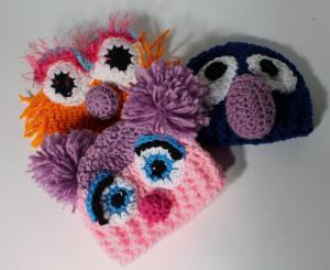 Crocheted Zoe, Abby Cadabby, and Grover Hats