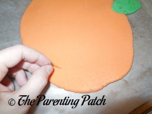 Pricking the Back of the Salt Dough with a Pin