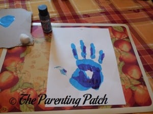 Layering the Purple Handprint on Top of the Blue Handprint