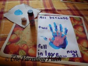 Layering the Pink Handprint on Top of the Purple Handprint