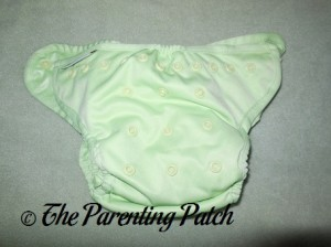 Front of Sweat Pea Buttons Diaper with Insert