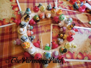 Sewing Halloween Rubber Ducks onto the Straw Wreath 10