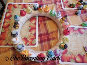 Sewing Halloween Rubber Ducks onto the Straw Wreath 5