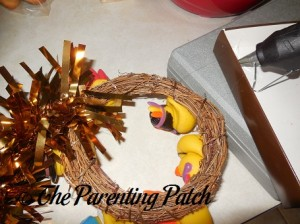 Hot Gluing the Gold Garland onto the Wreath