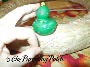 Sewing Christmas Rubber Ducks onto the Straw Wreath 2