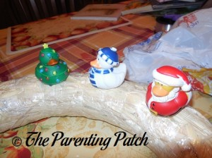 Sewing Christmas Rubber Ducks onto the Straw Wreath 3