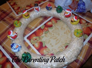 Sewing Christmas Rubber Ducks onto the Straw Wreath 4