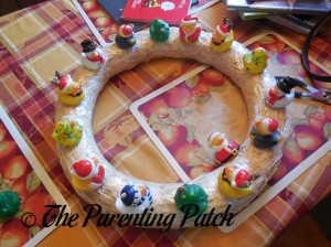 Sewing Christmas Rubber Ducks onto the Straw Wreath 5