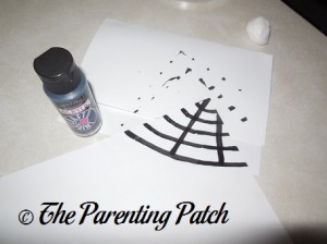 Painting a Black Spider Web