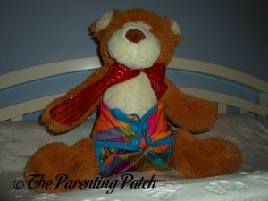 Smallest Setting of the Rumparooz One-Size Cloth Diaper Cover on Teddy Bear