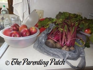 Raw Apples and Beets on a Kitchen Counter