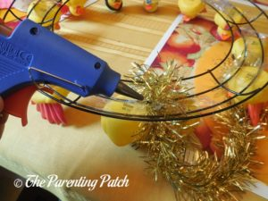 Gluing the Gold Garland to the Thanksgiving Duck-oration Wreath