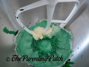 Adding Green Food Coloring to the Butter