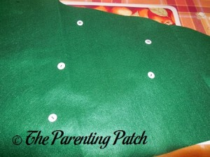 Sewing Buttons on a Felt Toddler Christmas Tree