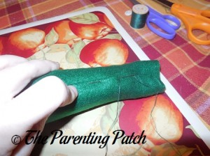 Sewing the Felt on the Cone of the Felt Toddler Christmas Tree