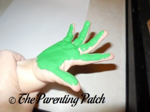 Green Paint on Toddler Hand