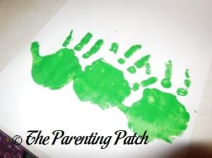 First Row of Green Handprints