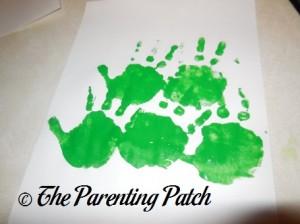 Second Row of Green Handprints
