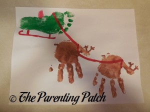 Santa's Sleigh and Reindeer Handprint-Footprint Craft