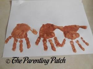 Three Brown Handprints
