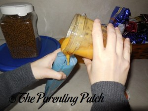 Pouring the Peach Smoothie into the Yummi Pouch