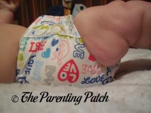 Side of Royal Fluff One-Size Pocket Diaper on Infant 1