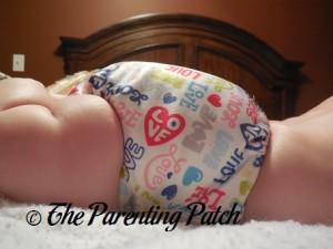 Side of Royal Fluff One-Size Pocket Diaper on Infant 2