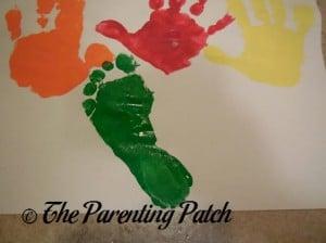 Green Footprint Under Handprints