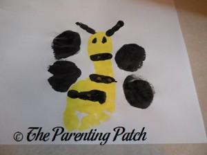 Black Palm Prints Next to Yellow Footprint