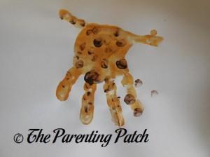 Brown Fingerprints on Gold Handprint