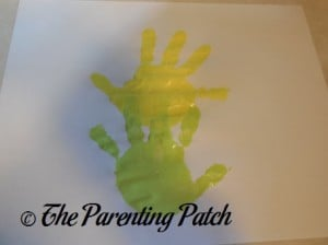 Green Handprint Under Yellow Handprint